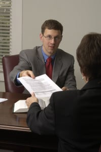Jason Perkins talks with a client about group health insurance