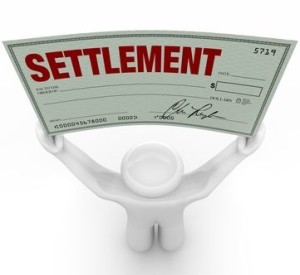 Man holding a settlement check