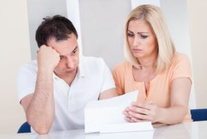 Couple with denial letter from VA