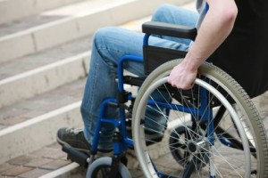 Man in wheelchair cannot go up stairs to get in house