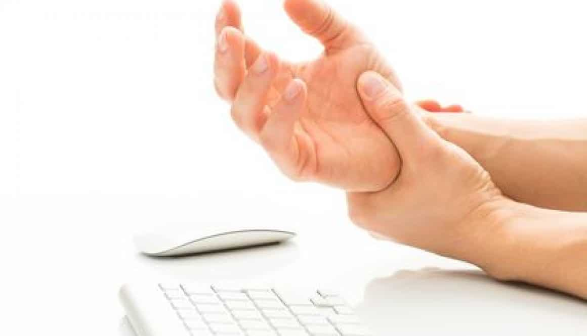 Pain from carpal tunnel syndrome from repetitive work on keyboard