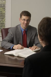 Workers' compensation attorney Jason Perkins talks with a client