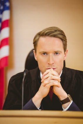 Male judge in court with american flag