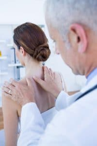 Shoulder orthopedic doctor with patient