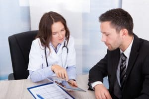 Case manager with doctor