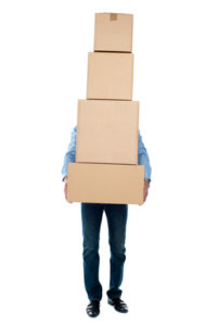 Man carrying heavy boxes