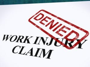 Workers compensation claim denied with stamp