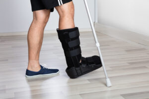Foot and ankle injury with walking boot and crutches