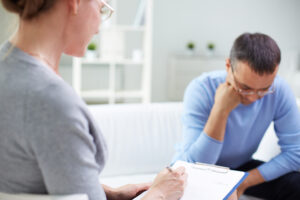 Female psychologist treating male patient for PTSD