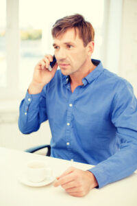 Middle aged man talking on cell phone