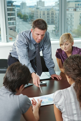 Business men and women at conference table in office for mediation
